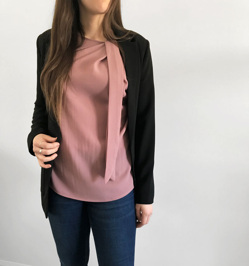 pink blouse with jeans and a with a profesionnal jacket made in quebec