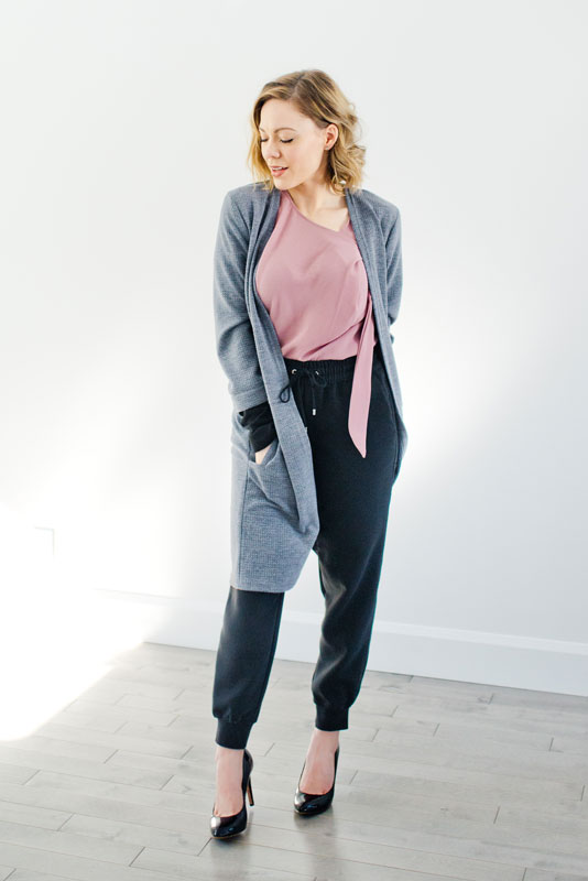 pink blouse, black pants and with grey cardigan made in quebec